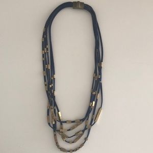 Anthropologie necklace - blue suede and gold.